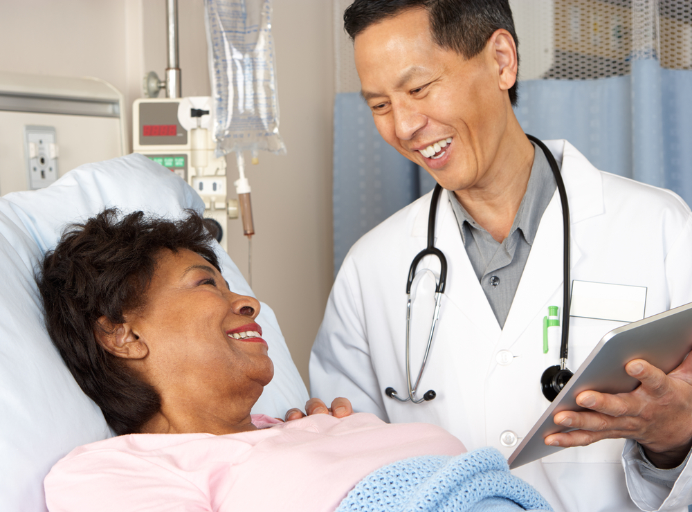 Smiling doctor with a patient