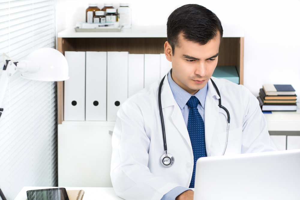 Doctor on laptop