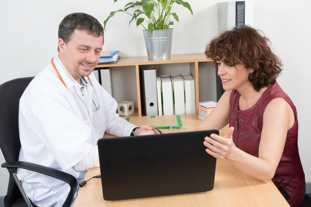 Doctor with patient using a tablet