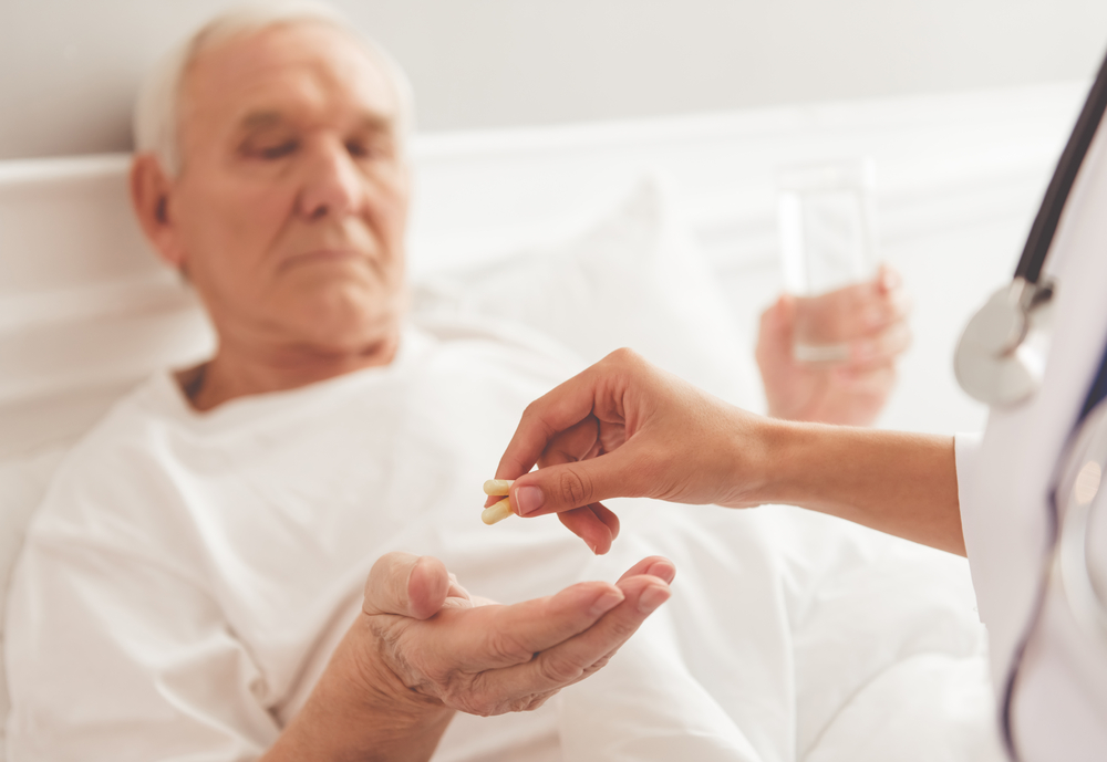 Patient being given opioid pills