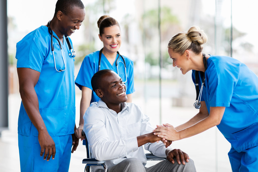Doctor greeting disabled patient in hospital