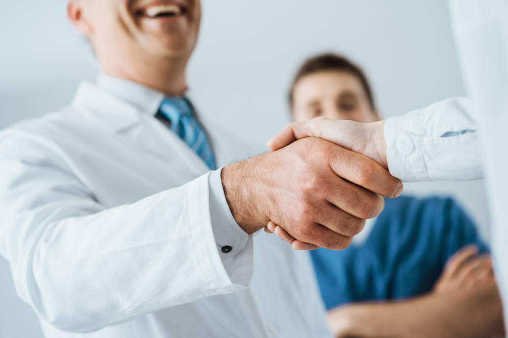 Medical professional giving a handshake
