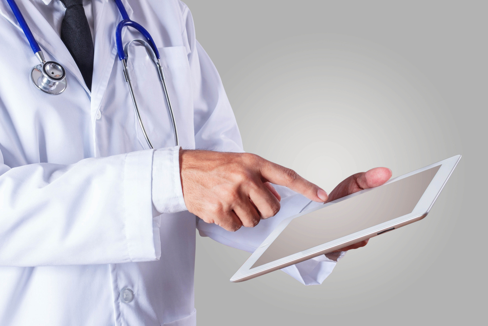 Physician using a tablet