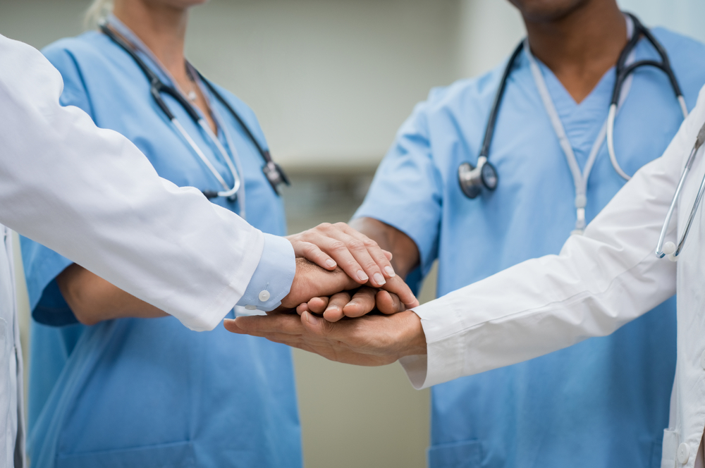 Medical providers stacking hands